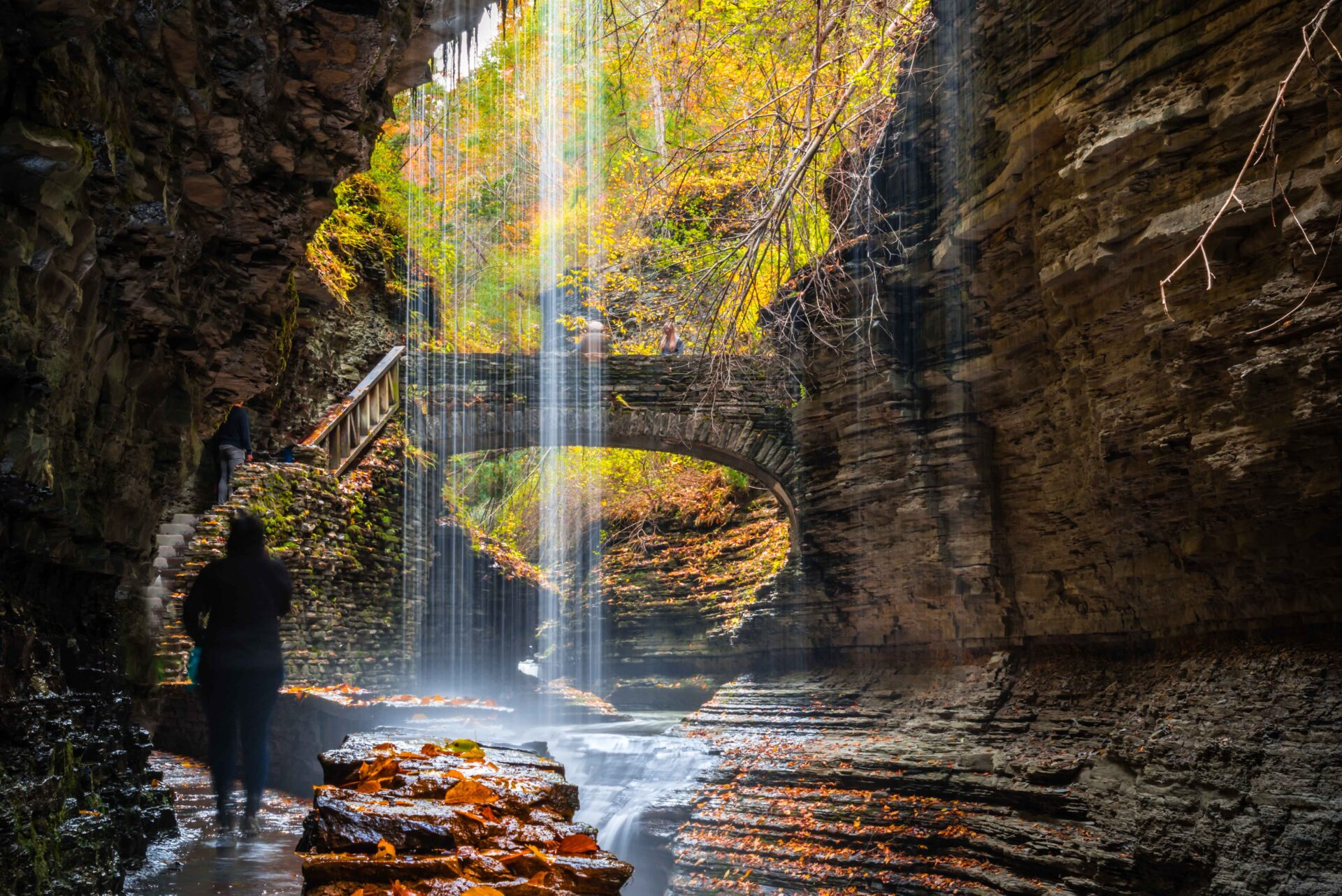 a stone bridge and waterfalls of Gorge trails in autumn of Letc